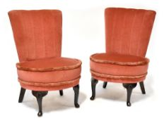 A pair of 1940s low side chairs raised on cabriole legs (2).