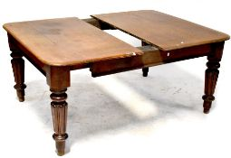 A Victorian mahogany extending dining table, for restoration, on bulbous turned tapering legs,