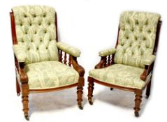 A pair of late Victorian mahogany gentlemen's armchairs with button back and seat,
