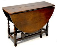 A late 17th/early 18th century oak oval gateleg table with end drawer,