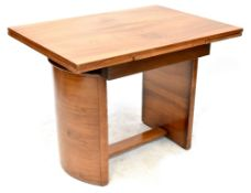 An Art Deco walnut draw-leaf table of rectangular form on half cylinder supports united by
