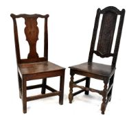 A late 17th/early 18th century carved oak high back hall or side chair,