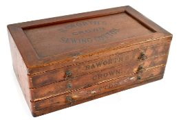 An early 20th century stained pine Raworth's Crown Sewing Cotton tabletop shop counter set of three