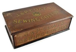 An early 20th century J & P Coats wooden set of shop counter display drawers with transferred