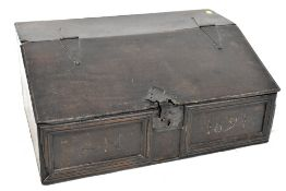 A late 17th oak Bible box, the hinged sloping lid enclosing a partial compartmentalised interior,