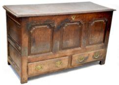An 18th century oak coffer,