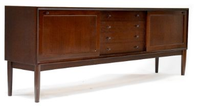 A retro Brahmin mahogany sideboard with four central drawers flanked by sliding doors,