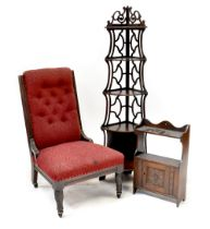 An Edwardian oak-framed nursing chair with button back red upholstery,