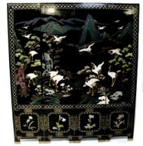 A modern Chinese black lacquer and Chinoiserie decorated four-leaf folding screen,