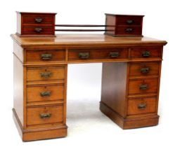An Edwardian mahogany desk, converted from a dressing table,