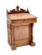 A reproduction oak and burr walnut Davenport with broken swan neck pediment and gallery top,
