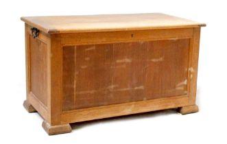 A modern oak blanket box with fielded panels, on block feet, height 55cm, width 96cm, depth 51cm.