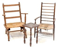 A ladder back rush seated open elbow chair,