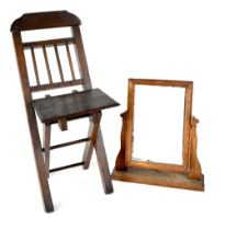 A small c1940s oak children's fold-up picnic chair and a rectangular dressing table swing mirror