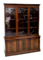 A reproduction mahogany bookcase,