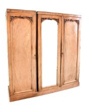 A Victorian mahogany matching linen press and single wardrobe, possibly converted from a triple,