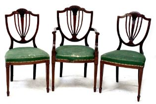 Three matching Regency-style mahogany dining chairs to include one carver,