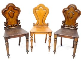 Three Victorian shield back hall chairs with tapering turned supports to peg feet (3).