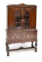 A reproduction sapele display cabinet,