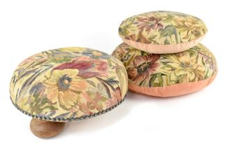 An Edwardian circular footstool on three bun supports,