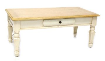 A modern country-style pine-effect coffee table with cream painted base, length 117cm.