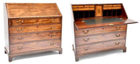 A George III cross banded and inlaid mahogany bureau,