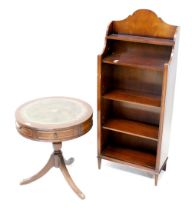 A reproduction mahogany drum table with tooled leather insert to top and two frieze drawers with