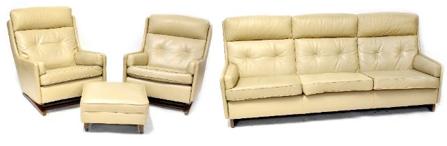 A 1960s three-piece suite comprising a three-seat settee, length 214cm,