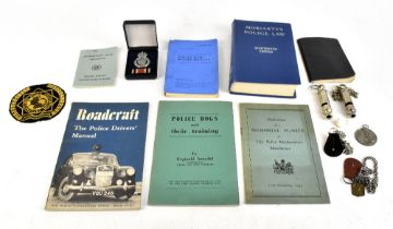 POLICE INTEREST; a collection of assorted ephemera relating to the police, to include whistles,