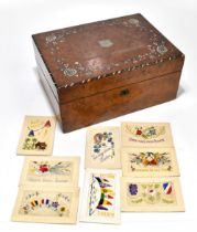 A Victorian mother of pearl inlaid walnut writing slope, with central shield shaped cartouche with