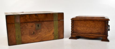 A Victorian walnut metal bound writing slope with central shield shaped vacant cartouche, length