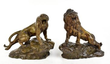 THOMAS FRANÇOIS CARTIER (1879-1943); a pair of late 19th/early 20th century bronze figures, lion and