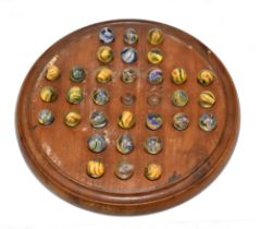 A 19th century solitaire board housing thirty one 19th century marbles with internal swirls, each