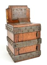 JUDAICA; a late 19th/early 20th century Tzedakah (charity) box, the oak body with iron frame and
