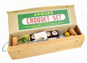 JAQUES & SON LTD; a boxed croquet set including mallets, balls, and hoops, with paperwork.Additional