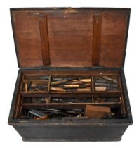 An old stained pine tool chest housing a large collection of assorted antique and later tools.