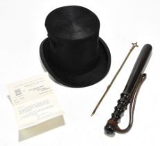 An ebonised police truncheon, together with a silk top hat by Woodrow of Manchester, and taper