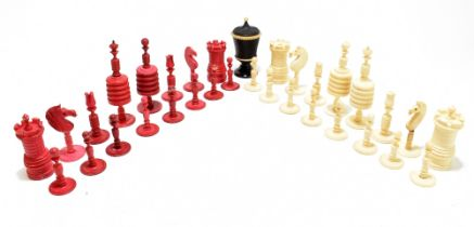 A late 19th century bone and stained bone carved chess set,height of kingapprox. 11.25cm, also a