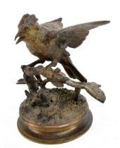 AFTER FERDINAND PAUTROT (FRENCH, 1832-1874); a bronze figure of a bird perching on a branch,