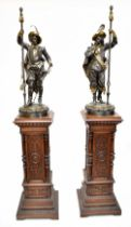 A large and impressive pair of late 19th century bronzed mixed-metal lamps modelled as Cavaliers,
