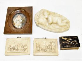A small white marble carving of a sleeping child, length 8.5cm, two relief plaques, a printed