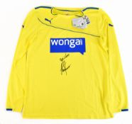 ALAN SHEARER; a Newcastle United Puma fluorescent yellow away shirt, signed and further inscribed '