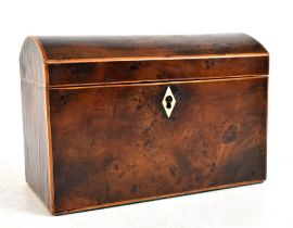 An early 19th century yew wood dome topped tea caddy, the hinged cover enclosing two compartments,