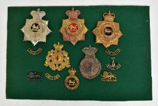 THE KING'S OWN ROYAL REGIMENT (ROYAL LANCASTER); four helmet/shako plates including First