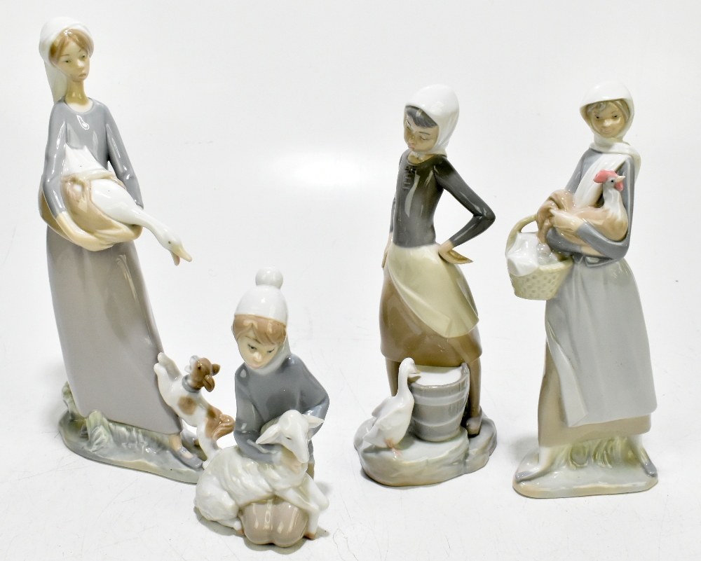 LLADRO; four boxed ceramic figures to include a girl clutching a goose whilst being attacked by a