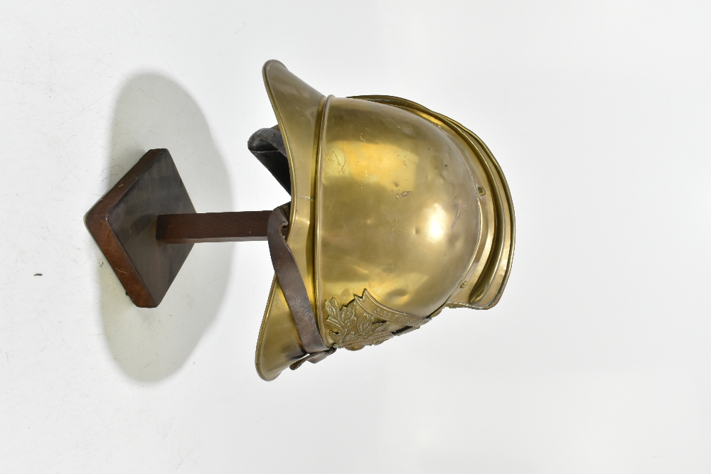 A French fireman's brass helmet with applied badge inscribed 'Sapeurs Pompiers De Neuille Le L.', - Image 2 of 6
