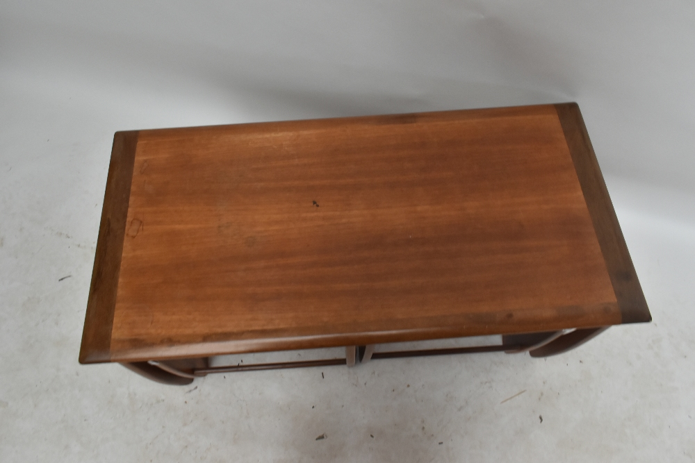 A G-plan teak nest of three coffee tables on shaped end supports, largest table height 51cm,width - Image 2 of 3