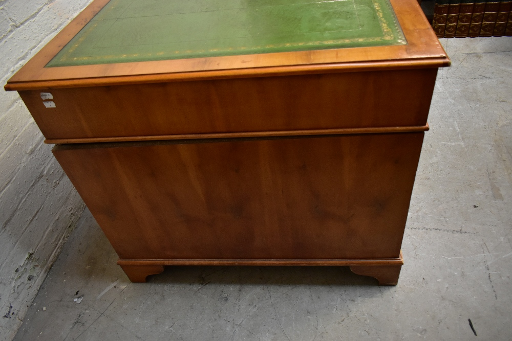 A reproduction yew wood pedestal desk, with green leather inset top above an arrangement of nine - Image 4 of 7