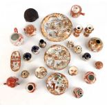 A collection of Japanese Katani and Satsuma ware predominantly miniatures including a double gourd