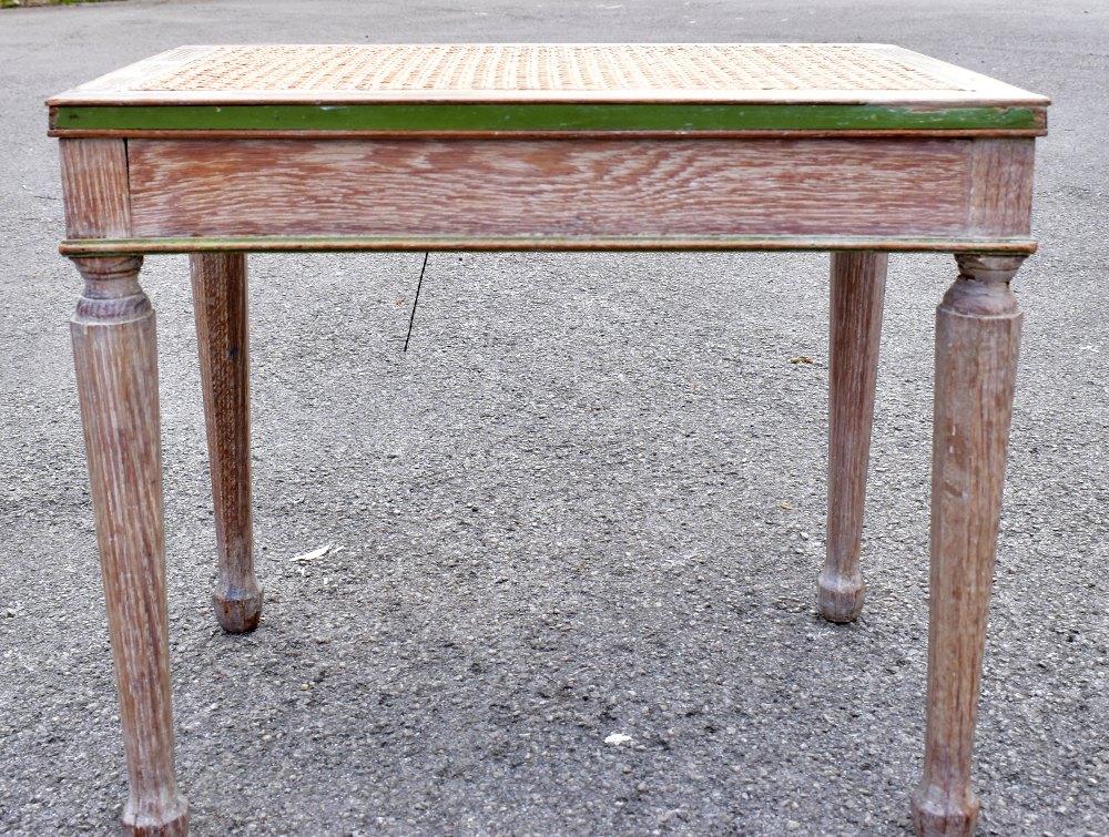 WILLIAMSON & COLE LTD; a limed oak cane seated stool, raised on octagonal column supports, length